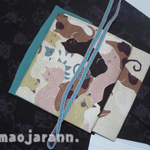 桜を偲んで着る、八重桜柄単衣の本場奄美大島紬。