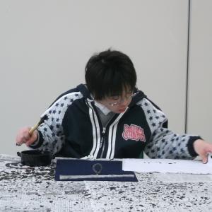 筆を握らない書道教室の息子
