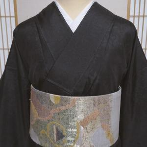 訪問着柄縞大島紬 オリエンタルな更紗柄×ぜんまい紬風洒落袋帯