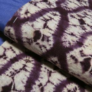 単衣 網目文様の紫根染×あかね色の無地 八寸真綿紬の帯