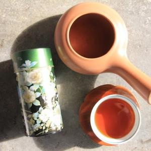 ヨーグルト風味のオレンジ入りマフィン と ほうじ茶