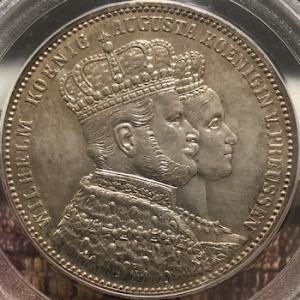 カップルが描かれたアンティーク銀貨