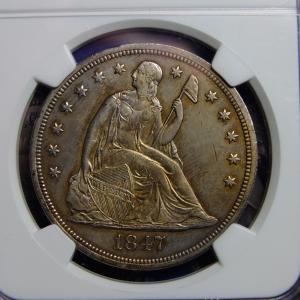 ヘリテージの落札品その1(1847年シーテッドダラー)