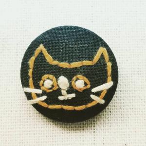 くるみボタンのネコちゃん。