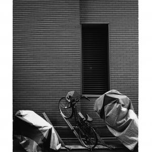 Bicycle parking lot installed in front of the wall in Ginza,Tokyo,Japan