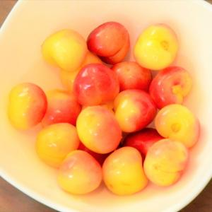 A plate full of cherries
