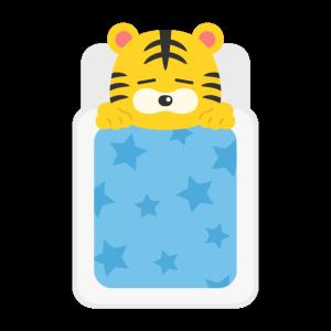 布団で寝る虎のキャラクターの無料イラスト