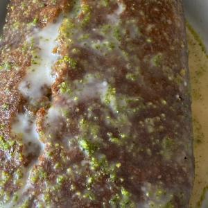 Pistachio, cardamom and lemon drizzle cake