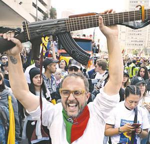 コロンビア反政府行進は音楽とともに(12月9日)