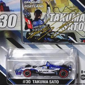 グリーンライト1/64佐藤琢磨選手ポートランド優勝ミニカーにサインを入れて頂いた