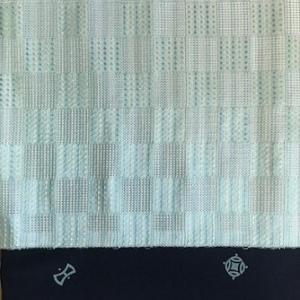 宝尽くしの小紋+はちす織の名古屋帯前太鼓。