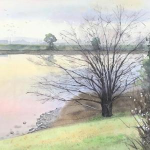黄昏時の川辺を描く