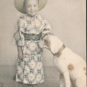 少年と犬(ヌイグルミ)