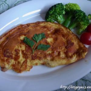チーズ入りオムレツと馬鈴薯/玉葱/トマト/米のリゾット