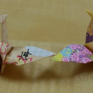 一羽の鶴に書かれた漢字は「海」