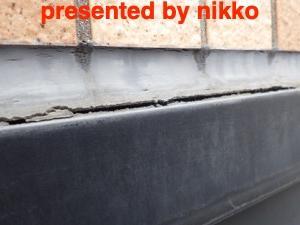 タイル壁の雨漏り修理。