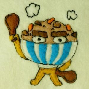 フェルトまんだら「ヒガシマル うどんスープオールスターズ」12人め:炊き込みごはんの「炊き込みジロー」