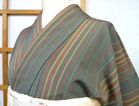 縞小紋と矢羽根の帯