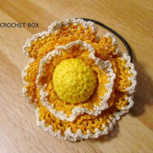 再販品のオレンジのお花のヘアゴムが仕上がりました。