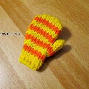 黄色地オレンジ線の小さいミトンの ブローチが仕上がりました。