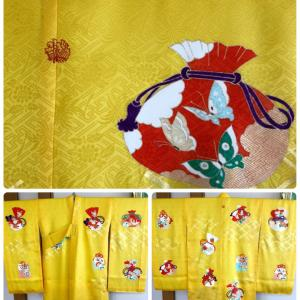 女の子用の黄色に巾着が描かれた可愛いお宮参りお祝い着のお仕立て!