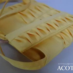 薄黄色でひらひらバッグ
