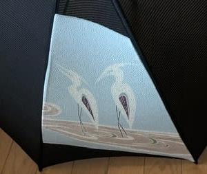 「白鷺模様の帯で作る日傘」