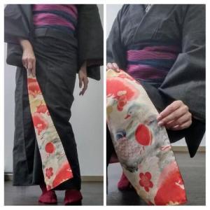 八掛に鴛鴦の古布を縫い付けた紬の着物