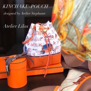 オレンジ色のKINCHAKU-POUCH/お薦め暖房器具