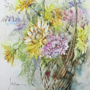 今年初の向日葵と咲き残った額紫陽花