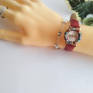 ミルフィオリの時計と、真鍮のイヤーカフ。
