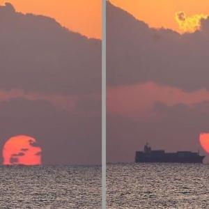 雲に蝕まれた朝陽
