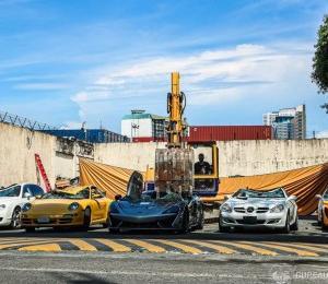 フィリピン政府 ポルシェ911破壊!!ショベルカーで高級車21台を。。。