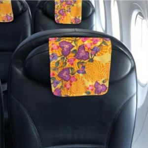 日本トランスオーシャン航空で「琉球紅型座席ヘッドレストカバー」を展開中!