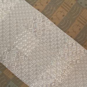 夏大島と琥珀織の帯
