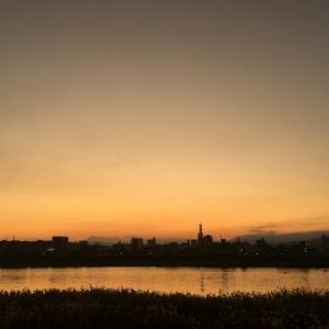 傾く西日を浴びる - 大分川 -