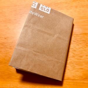 紙袋でブックカバーを作りました。