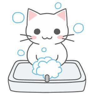 洗面台で手を洗う猫のイラスト